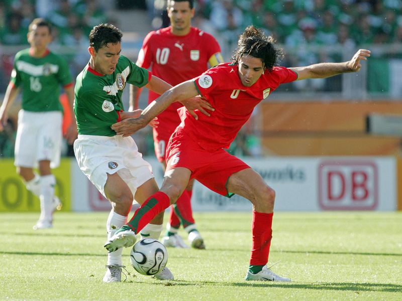 Omar Bravo (left, Mexico) against Javad Nekounam (Iran) at the 2006 World Cup in Germany