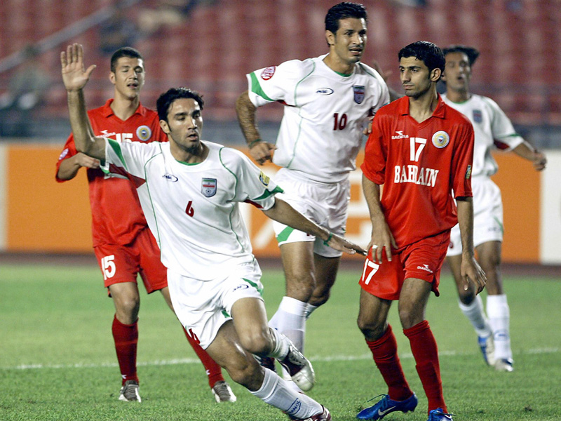 Javad Nekounam (left, Iran) celebrates after scoring against Bahrain in the Asian Cup 2004