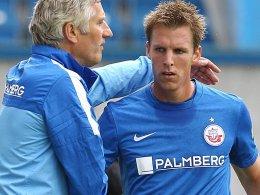 Hansa-Trainer Bergmann mit Stürmer Plat