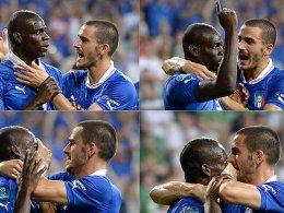 Der Bodyguard bringt den Rockstar zum Schweigen: Leonardo Bonucci zügelt Mario Balotelli (li.).