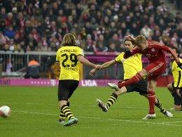 Sein Führungstor reichte nicht zum Bayern-Sieg: Toni Kroos gibt Marcel Schmelzer und Neven Subotic das Nachsehen.