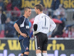 Wieder vereint: Lukas Podolski und Michael Rensing.