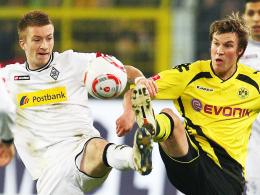 Schlechte Erinnerungen: Marco Reus verlor im Hinspiel mit Gladbach deutlich mit 1:4 in Dortmund. Rechts Kevin Großkreutz.