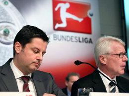 Gaben die Entscheidung in der TV-Rechtevergabe bekannt: DFL-Geschäftsführer Christian Seifert und Präsident Reinhard Rauball (re.).