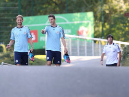 Benedikt Höwedes, Julian Draxler und Bundestrainer Joachim Löw (v.l.)