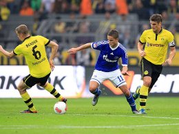 Seven Bender und Sebastian Kehl gegen Ibrahim Afellay.