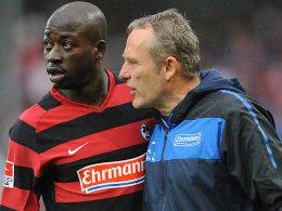 Dembelé (li.) und SC-Coach Christian Streich