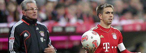 Nach Meinung der kicker-Leser nicht mehr zu stoppen: die Bayern um Kapitän Philipp Lahm und Trainer Jupp Heynckes.