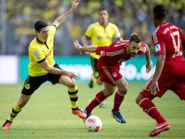 Lewandowski müht sich vergeblich gegen Contento und Alaba.