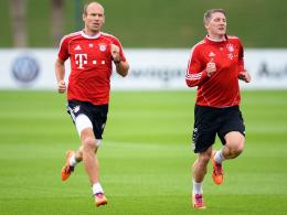 """""""Basti ist, glaube ich, schon ein bisschen weiter als ich"""": Bayerns Arjen Robben (li.) und Bastian Schweinsteiger im Trainingslager."""