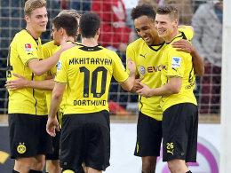 """Gute Laune beim BVB: Gegen Lüttich gewann Dortmund mit Mkhitaryan (Mi.), der auf der """"Acht"""" spielte."""