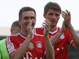 Philipp Lahm und Thomas Müller (re.)