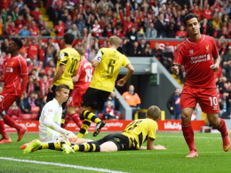 Einseitige Angelegenheit: Philippe Coutinho (re.) jubelt über seinen Treffer gegen Dortmund.
