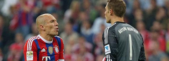 Die Münchner Arjen Robben und Manuel Neuer bekommen es am Samstag mit den kriselnden Schalkern zu tun.
