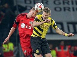 Lars Bender im Duell mit Dortmunds Ciro Immobile