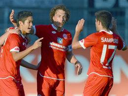 Die Mainzer Muto, Baumgartlinger und Jairo bejubeln einen Treffer gegen Lazio.