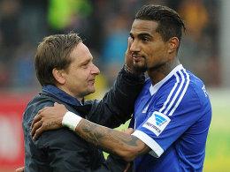 Horst Heldt (l.), Kevin-Prince Boateng