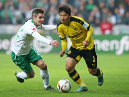 Neuer Job: Bremens Fin Bartels, hier links gegen Dortmunds Joo-Ho Park, musste als Rechtsverteidiger ran.
