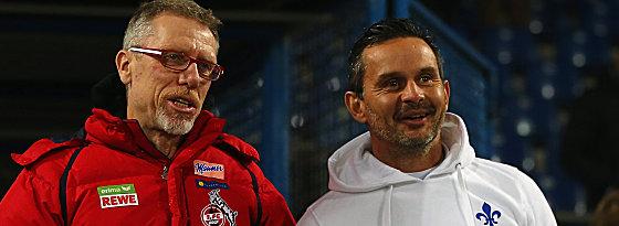 FC-Trainer Peter Stöger und Darmstadts Coach Dirk Schuster