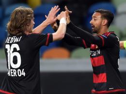 Dem Jubel in Lissabon soll nun Freude gegen Dortmund folgen: Leverkusens Karim Bellarabi (re.) und Tin Jedvaj.