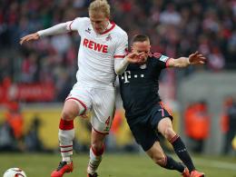Kein Vorbeikommen: Kölns Frederik Sörensen (li.) behauptet den Ball gegen Franck Ribery.