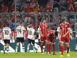 Hängende Köpfe: Liverpool düpiert Bayern München