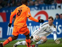 Im Brennpunkt: Manuel Neuer (re.), hier gegen Hoffenheims Ryan Babel, bewahrte sein Team ein ums andere Mal vor einem höheren Rückstand