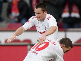 Die Doppeltorschützen: Podolski stemmt Clemens.