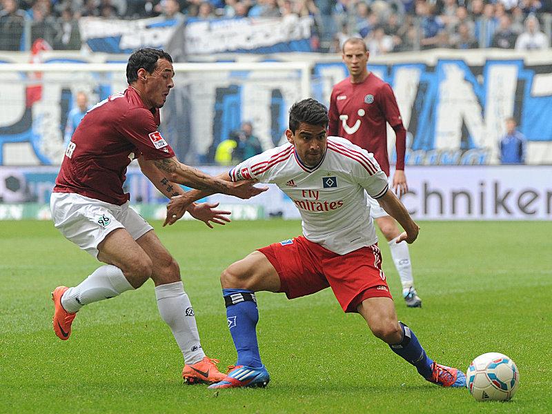 Hiergeblieben! Hannovers Pinto hält Hamburgs Rincon.