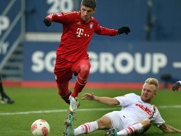 Müller im Duell mit Vogt (re.)