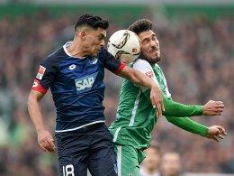 Hoffenheims Amiri (li.) gegen Bremens Garcia.