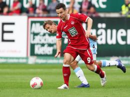 Deutete seine Klasse nur an: Kaiserslauterns Neuzugang Alexander Baumjohann. Hinten Münchens Bülow.
