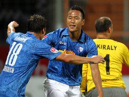 Federico (li.) und Chong Tese feiern
