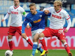 Bochums Ken Ilsö gegen Kölns Marcel Risse.