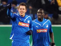 Goalgetter: Hoffenheims Sigurdsson feiert das 1:0, Demba Ba (re.) legte zum 2:0 nach.