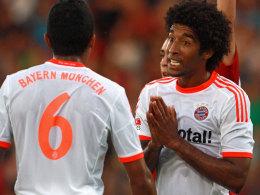 Dante und Luiz Gustavo (Nr. 6) müssen vorzeitig nach Brasilien reisen.
