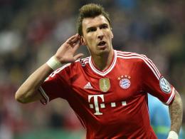 Abschied aus München? Das Tischtuch zwischen Bayern-Trainer Pep Guardiola und Angreifer Mario Mandzukic scheint zerschnitten.