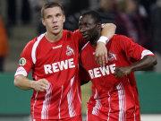 Manasseh Ishiaku (re.) und Lukas Podolski