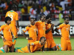 Neuer Anlauf: Im Vorjahr scheiterte die Elfenbeinküste mit Top-Star Didier Drogba (am Boden) im Elfmeterschießen des Finales.