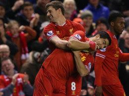 Kapitän Steven Gerrard brachte die Reds auf die Siegerstraße, Luis Suarez freut sich mit.