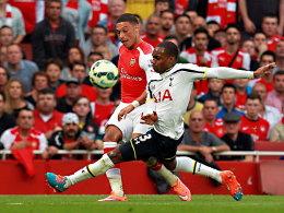 Laufduell: Arsenals Oxlade-Chamberlain im Zweikampf mit Danny Rose (vorne).