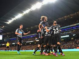Jubelten im Etihad: Die Spieler von Newcastle United nach dem Erfolg gegen ManCity.