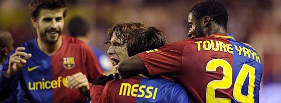Gerard Piqué, Carles Puyol, Lionel Messi und Yaya Touré
