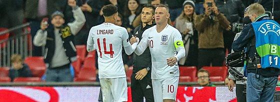 Ein letztes Mal: Wayne Rooney (r.) machte gegen die USA sein 120. und letztes Länderspiel.