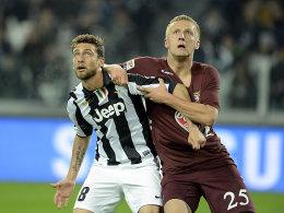 Marchisio (li.) schoss Juventus gegen den FC Turin in Front, sein Gegenspieler Glik flog in der ersten Hälfte vom Platz.