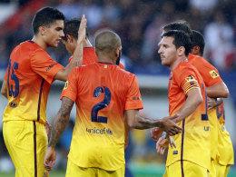 Lionel Messi (r.) jubelten mit seinen Kollegen in Paris