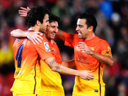 Fabregas, Messi, Xavi (von links)