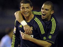 Cristiano Ronaldo (li., mit Pepe) machte den Unterschied und erzielte beide Tore in Vigo.