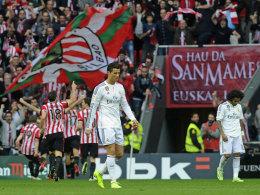 Rückschlag im Titelkampf: Cristiano Ronaldo (li.) und Real Madrid enttäuschten in Bilbao.