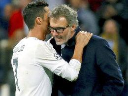Flüsterpost: Cristiano Ronaldo und Laurent Blanc nach dem Duell zwischen Real und PSG am Dienstag.
